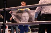 Олександр Хижняк після поединку розгорнув постер з зображенням загиблого музиканта Кузьми Скрябіна